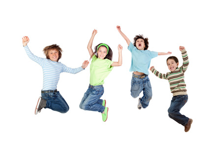 Four joyful children jumping isolated on a white background