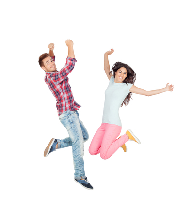 Couple of young lovers jumping isolated on a white background
