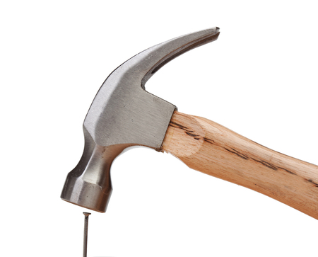 Hammer hitting a nail isolated on white background Archivio Fotografico