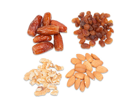 Raisins, nuts, dates and almonds isolated on a white background   photo