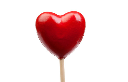 Red candy with shaped heart isolated on a white background photo