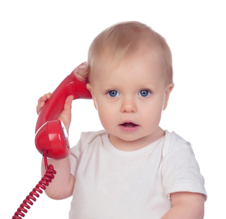 Beautiful baby with a red phone isolated on a white background photo