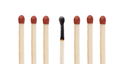 pyromaniac: Many matches without burning and a burned match isolated on  a white background