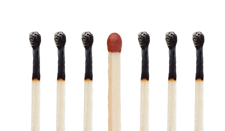 Many burned matches and a match without burning isolated on  a white background