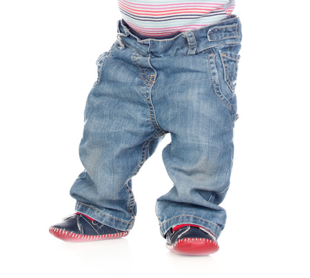 waist down: baby standing waist down isolated on a white background