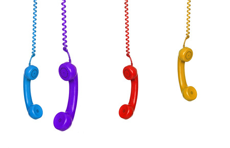 Four colored phones hanging isolated on white background  photo