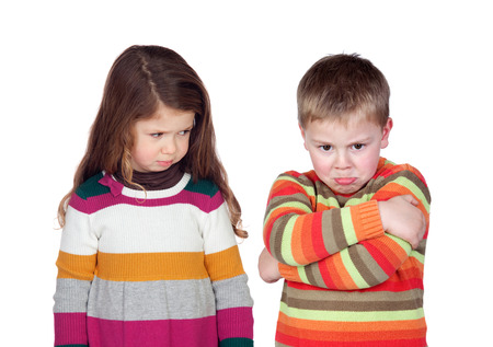 Two angry children isolated on a white background Standard-Bild