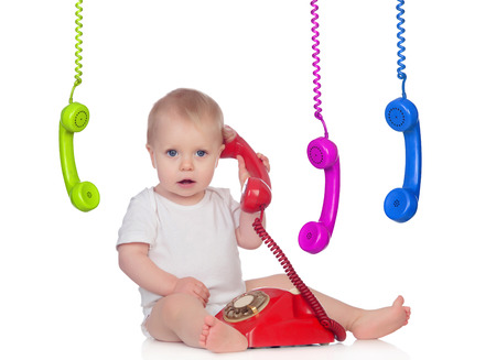 Beautiful baby with many telephones isolated on a white background photo