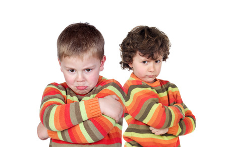 Two children with the same jersey angry isolated on a white background
