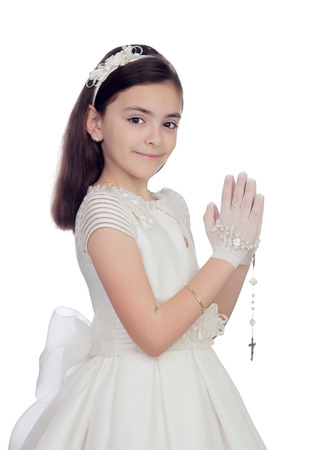 Adorable little girl dressed in communion isolated on white background