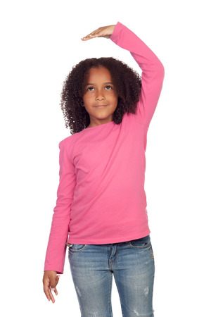 tallness: African girl measuring what has grown isolated on white background