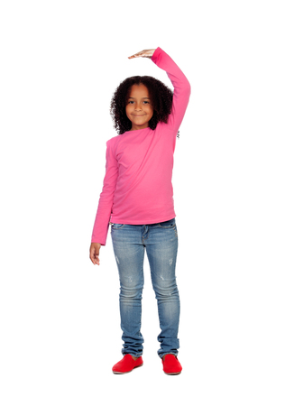 human height: African girl measuring what has grown isolated on white background