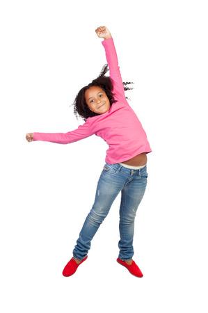niños bailando: Funny girl saltando aislados sobre un fondo blanco Foto de archivo