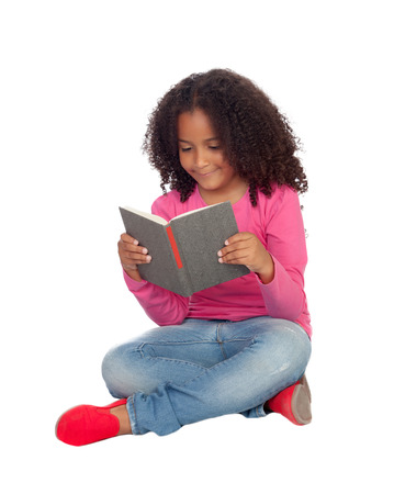 Little student girl reading isolated on a white background photo