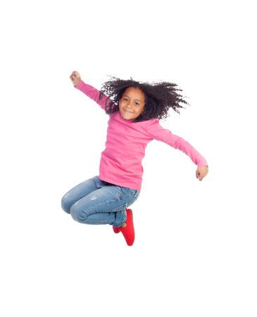 niños danzando: Funny girl saltando aislados sobre un fondo blanco Foto de archivo