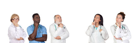 Pensive medical team isolated on a white background photo