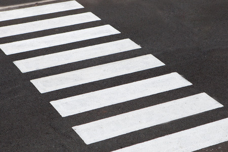 White stripes of a zebra crossing on the road