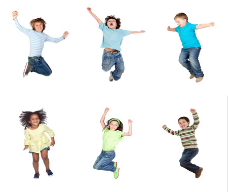 Happy children jumping isolated on a white background Imagens