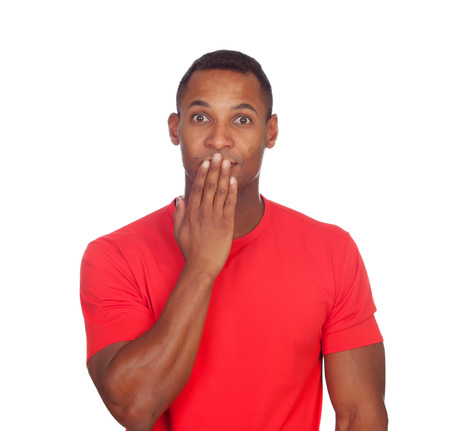 Surprised latin man solated on a white background photo