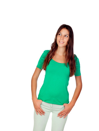 Atrractive young girl in green isolated on a white backgrund photo