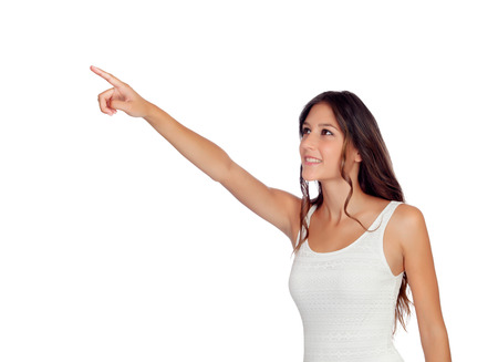 gril: Attractive casual gril pointing something isolated on a white background Stock Photo