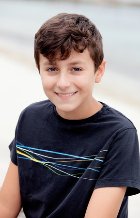 preteen boy: Nice preteen boy smiling with a black t-shirt Stock Photo