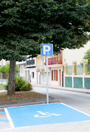 Parking for disabled people in a street of a village