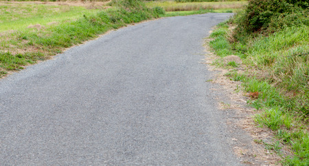 unmarked: Rural unmarked road in the countryside Stock Photo