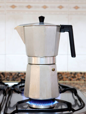 stainless steel pot: Coffee set on the fire of a gas cooker Stock Photo