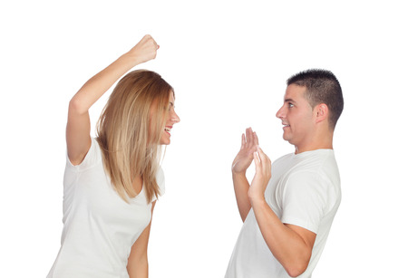 Funny couple simulating a discussion isolated on a white background photo