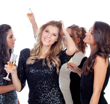 Elegant women celebrating christmas dancing in the party isolated on a white background photo