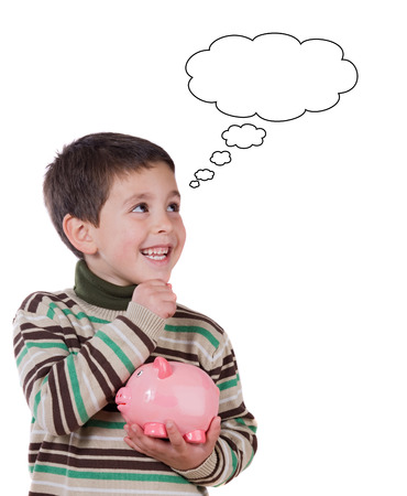 Smiling child with a moneybox thinking isolated on a white background photo