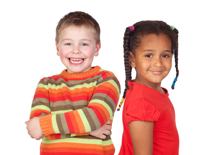 African little girl and caucasian blond kid isolated on a white background photo