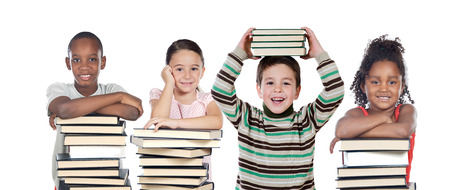 Four children with many books isolated on a white background Imagens