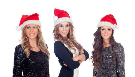 mujeres elegantes: Mujeres elegantes con sombrero de Navidad aislado en un fondo blanco
