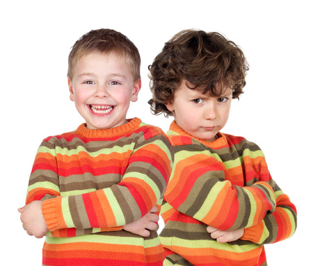 alike: Pair of twins dressed alike with varying degrees of mood