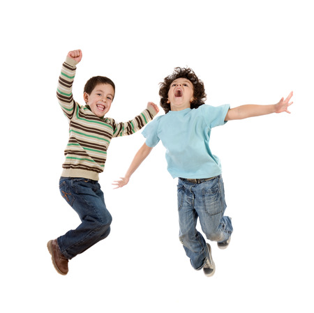 Crazy kids jumping with joy isolated on a white background Imagens