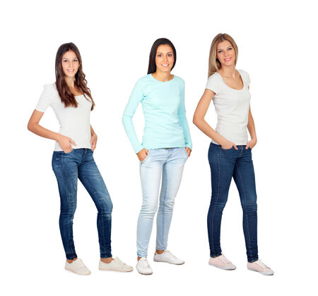 Three casual young women isolated on a white background photo