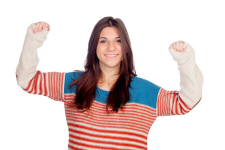 Casual girl celebrating something isolated of background photo