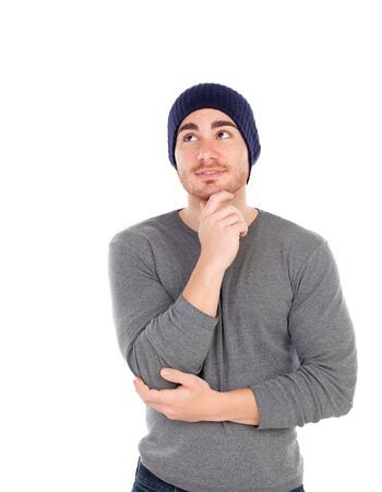 muscled: Pensive muscled man with wool hat isolated on a white background Stock Photo