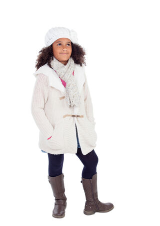 girl boots: Pretty african girl lookin up with winter clothes isolated on a white background Stock Photo