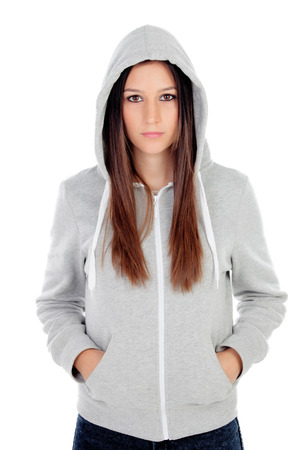 Sad teenager girl with gray sweatshirt hooded isolated on white background Stockfoto