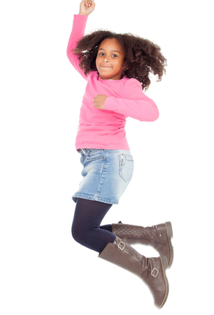 african dance: Adorable african little girl jumping isolated on white background
