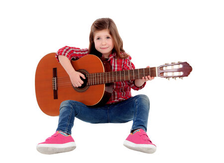 Adorable little girl playing guitar isolated on white background photo