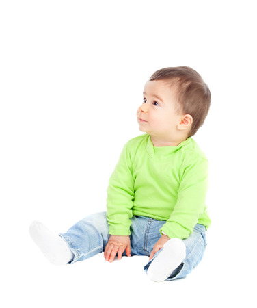 0 6 months: Beautiful baby  sitting on the floor looking up isolated Stock Photo