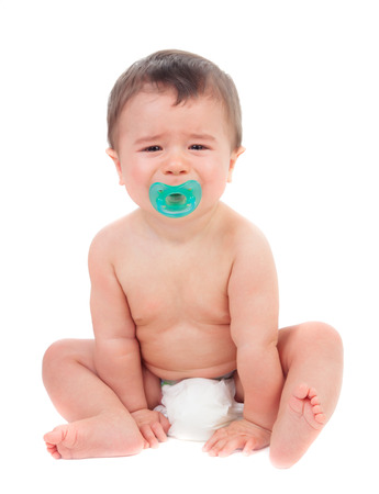Cute baby crying with pacifier isolated on a white background Stock Photo