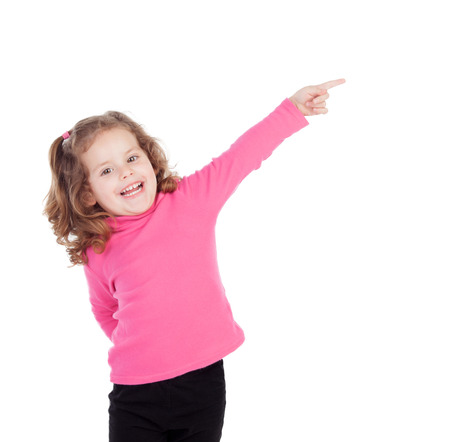 pretty little girl: Little girl in pink indicating something isolated on a white background Stock Photo