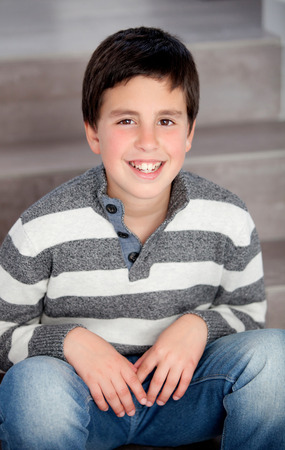 preteen boy: Preteen boy sitting on the stairs at home Stock Photo