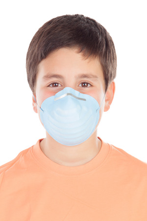 Boy of about twelve with allergy mask isolated on white background