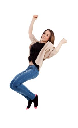Happy young woman jumping isolated on a white background photo